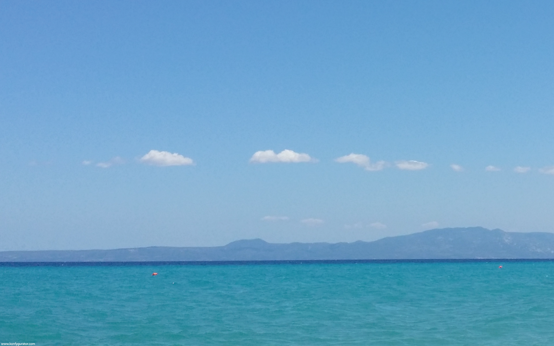 sea, distant mountains, blue sky